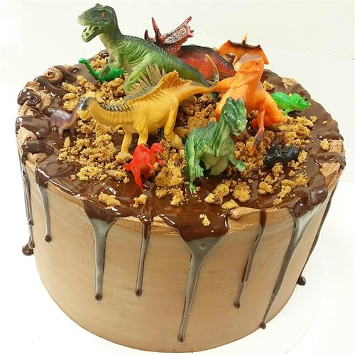 Specialty dinosaur cake for a dinosaur loving little boy and his birthday party