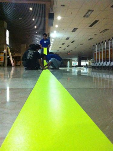 Installing our glow in the dark floor vinyl in Cebu Airport Philippines