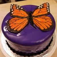 Monarch Butterfly made from modeling chocolate on a red velvet w fondant cake