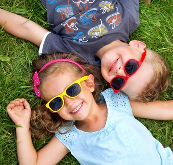 Gallery Image stockfresh_3420073_picture-presenting-kids-relaxinng-on-the-grass_sizeXS.jpg