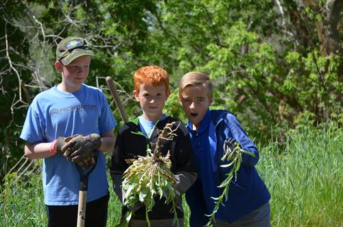 Service is an important part of character development at Promontory School.  These students are weeding a local park for Better World Day.