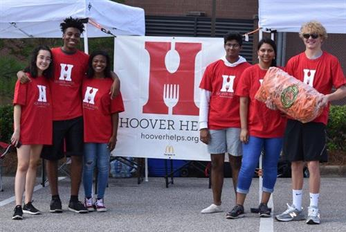 Hoover DECA distributing boxes of food to families in need