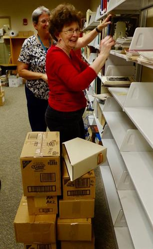 Carolyn Kolar and Liz Wells unpacking books