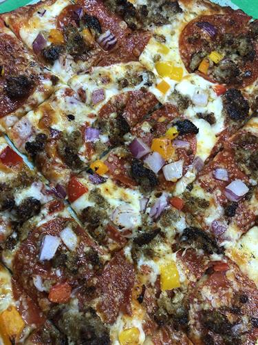 Classic Italian - Our famous pizza featuring our sauce & sausage seasoned for the Northwoods and gourmet pepperoni