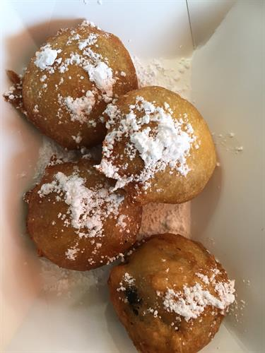 Deep fried Oreos topped with powdered sugar