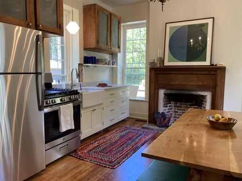 Beautiful new kitchen, harvest table seats six.