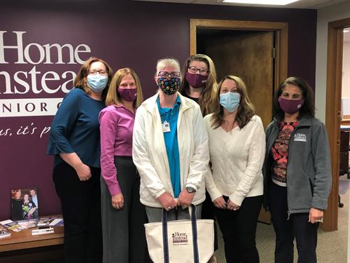 The Home Instead Team Honoring the April CAREGiver of the Month, Deb