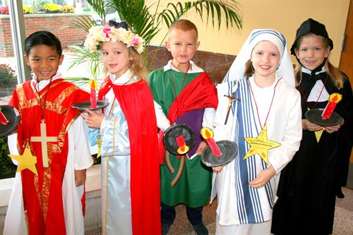 ICGS 1st Graders Dressed as their Patron Saints at All Saints Day Mass