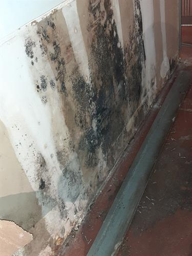 Water damage visible on wall