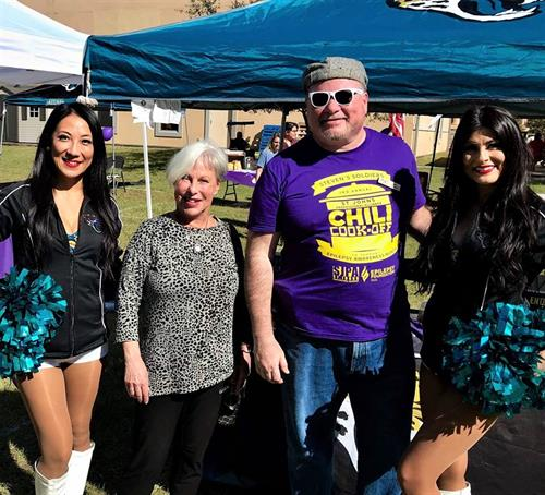 Family Tree President, Jeff Sedlitz with St Augustine Mayor Nancy Shaver and the ROAR cheerleaders at a fund raising event