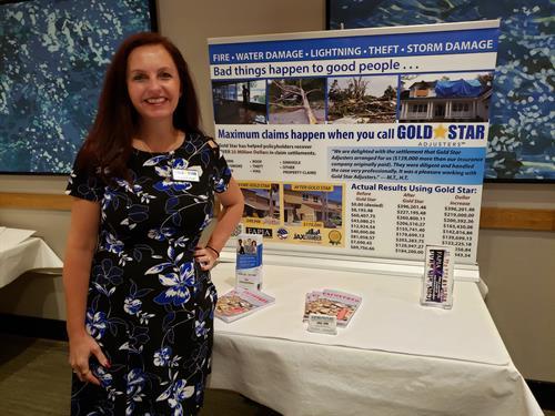 Yvette Forrest at Gold Star sponsor table