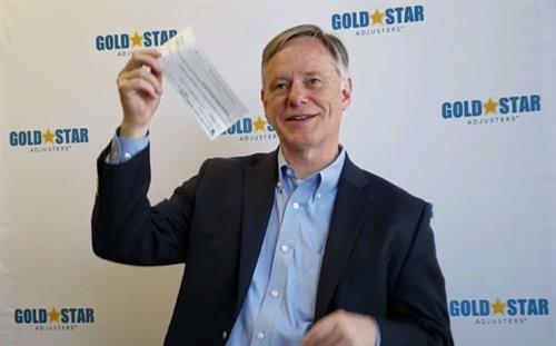 Doug Wilder with a much larger settlement check