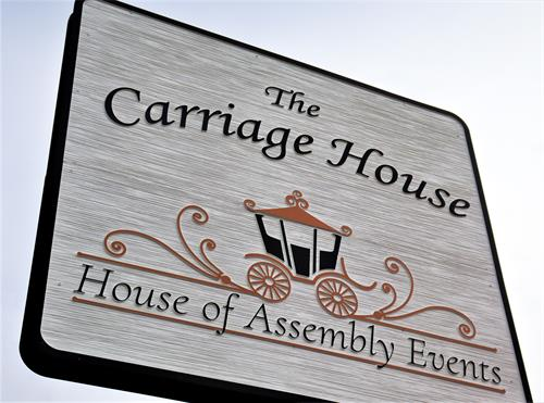 The Carriage House street sign