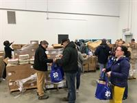 Volunteers loading perishables