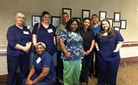 A class of graduates from our CNA class through our Workforce Program