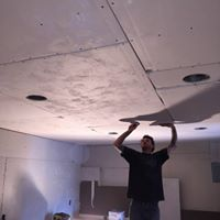 David working on hanging a ceiling.