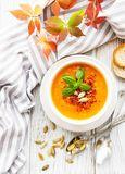 Gallery Image bowl-pumpkin-soup-bowl-pumpkin-soup-fresh-pumpkins-autumn-leaves-rustic-wooden-background-146529424.jpg
