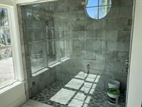 Gallery Image Shower_door_and_panel_and_transom-_Hydroshield.jpg