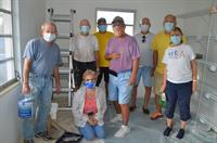 Members paint two rooms for the Venice Area Pregnancy Care Center
