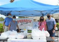 Assisting Paradise Grill with distributing free meals on Fridays to those in need.