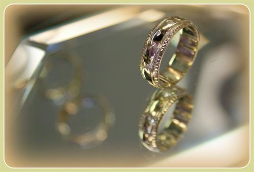 A variety of loose diamonds set into a two-tone frame makes a beautiful band!