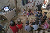 Group of children watching SAT-7 KIDS program