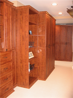 Luxury wood tone walk in closet