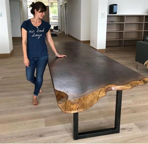 We handcraft custom furniture, like this live edge dining table