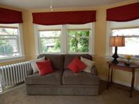 Pearl's living room, sleeper sofa.