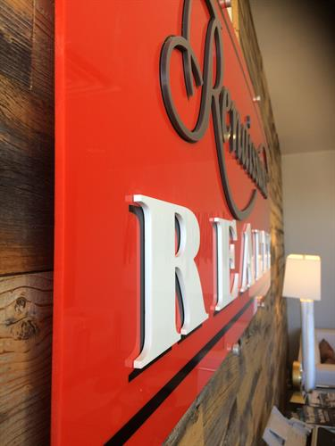 Interior red acrylic sign with routed acrylic letters