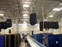 Overhead slings transport linen throughout the plant.