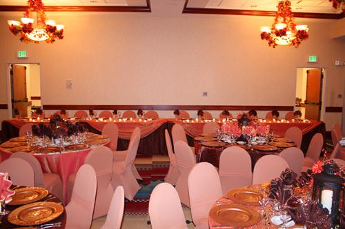 Crushed Shalimar tablecloth, fall foliage decor and centerpieces, and spandex chair covers