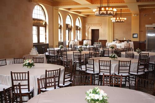Chiavari chairs with champagne satin tablecloths.