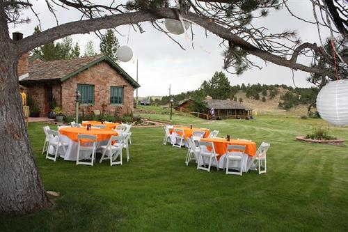 Orange polyester tablecloths with white garden chairs