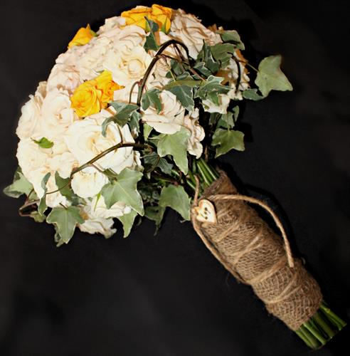 Yellow & white spray roses accented with ivy and tied with burlap bouquet