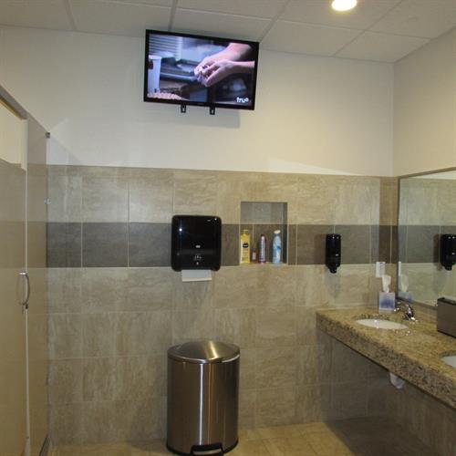 TV in all the restrooms, so you never miss a minute of the game.