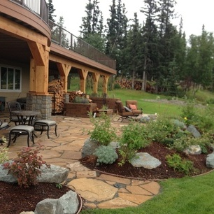 We designed this patio landscape to be both functional and aesthetically pleasing. This landscape project included custom built multi-layer planters, grass installation, boulder rock gardens, walkways, trees, shrubs, flagstone patio and a fire pit to enjoy all year long.