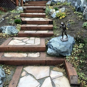 These steps were created from timbers and inlaid with flagstone. These steps climb in elevation as they head for the front door.