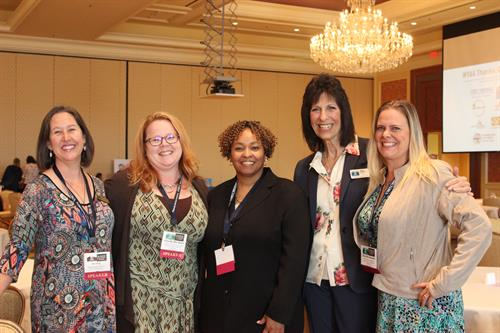Kathryn King, Wendy Weisbart, Dr. Sylvia Lyles, Director Linda Barton, and Danielle Bowen network at the 10th Annual WYAA State Conference.