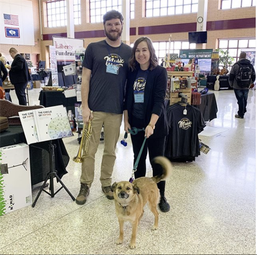 WYOmusic owners Danica and Andy with shopdog Penny at Wyoming All State 2020