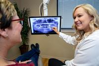 Dr. Wittorf reviews a patient's smile!