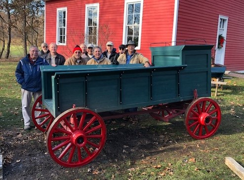 Northville Historical Society's Stone Gang Installs Refurbished Wheels to Wagon at MRV