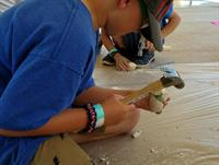 learning about fossil digs at Cub Scout Summer Day Camp