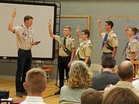 New Eagle Scouts take the Eagle Oath at an Eagle Court of Honor