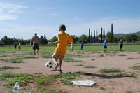 Good ol' fashioned kickball game at Cub Scout Summer day camp