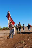 A patrol marches to morning flag ceremony at Cochise District camporee