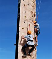 Scouts conquer the climbing tower at a camporee