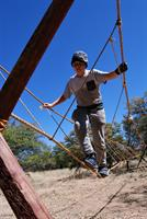 crossing a rope bridge at Cochise District camporee