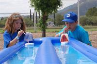 Cub Scouts participating in Raingutter Regatta at Cub Scout Summer Day Camp