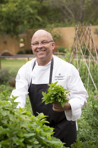 Chef Cal Stamenov in onsite organic gardens